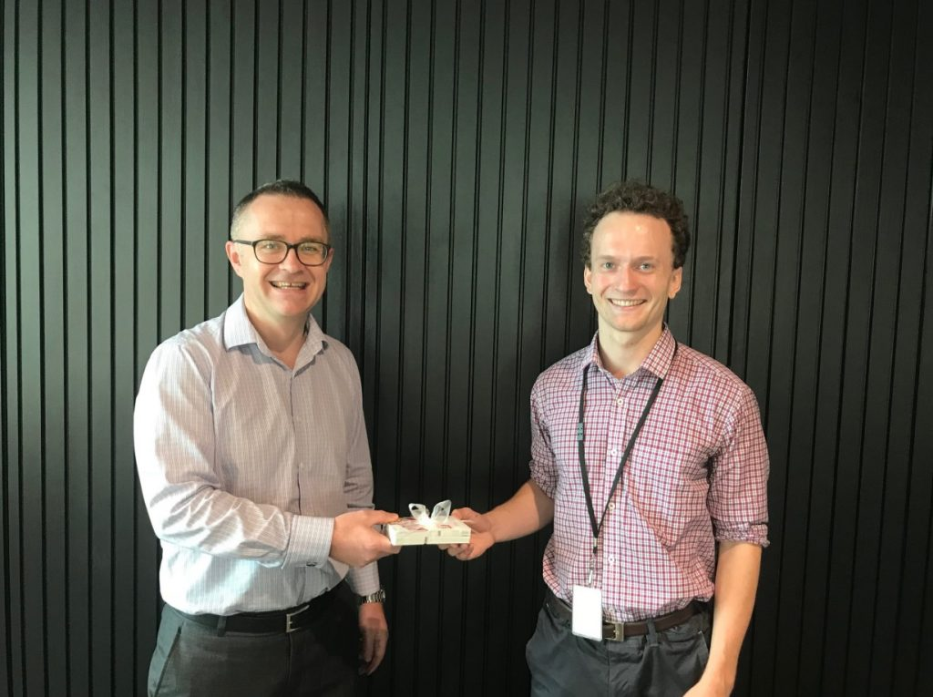 Auckland Partner Chris Bargery presenting New World Vouchers to Josh from the Auckland City Mission